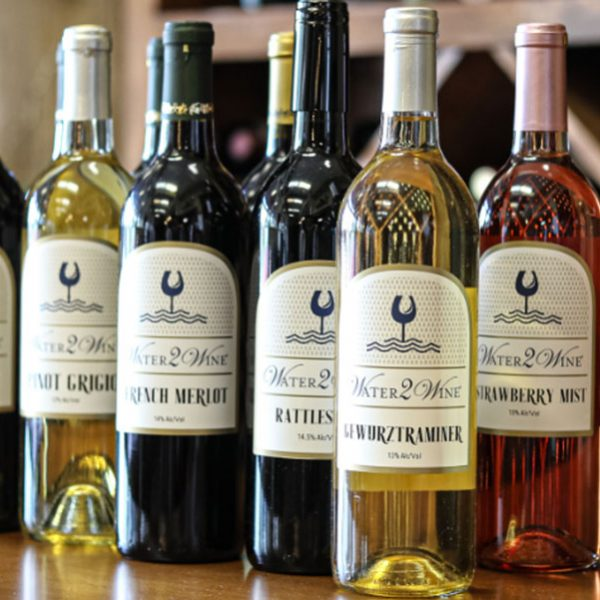 red white and rose wines with logo labels from water 2 wine austin neighborhood winery
