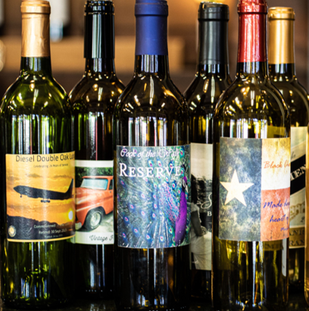 bottles of wine with customized labels for gifts from water2wine neighborhood winery buda tx
