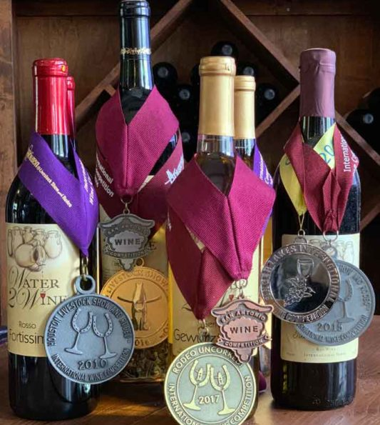 bottles of wine from Water 2 Wine with medals for awards