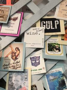 assortment of custom-designed wine labels from Denver winery